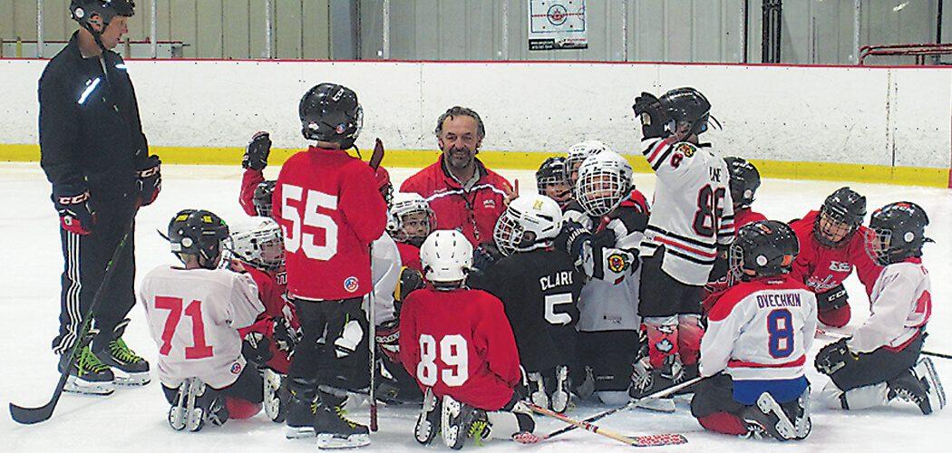 Nelson Burton with a youth hockey team